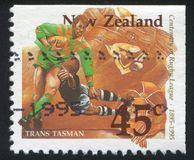 Rugby Match. NEW ZEALAND - CIRCA 1995: stamp printed by New Zealand, shows Rugby Match, circa 1995 Stock Photos