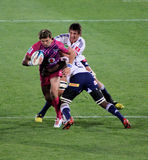 Rugby Olivier Tackled South Africa 2012. Rugby,Wynand Olivier, Bulls, in Pink jerseys in support of fighting cancer, getting tackled, Stormers v Bulls, Super Stock Photos