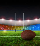 Rugby penalty kick - Night. Rugby stadium in night time and ball ready for penalty kick Royalty Free Stock Images