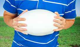 Rugby player with ball Stock Image