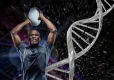 rugby player with ball, iron dna chain and black background Royalty Free Stock Photo
