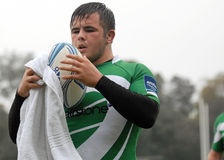 Rugby player with ball and towel Stock Image