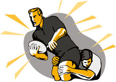 Rugby player being tackled Royalty Free Stock Images