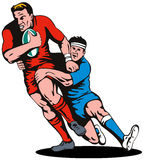 Rugby player being tackled Royalty Free Stock Image