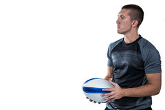 Rugby player in black jersey holding ball Stock Image