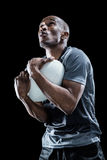 Rugby player catching ball while playing Royalty Free Stock Photography