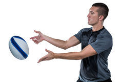 Rugby player catching ball Royalty Free Stock Photography