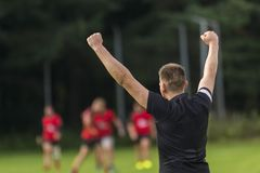 Rugby player celebrating a goal on a rugby field stock images
