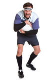 Rugby player cut out on white Royalty Free Stock Images