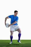 Rugby player doing a side pass Royalty Free Stock Image