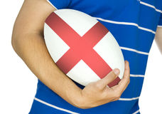 Rugby player with england rugby ball Royalty Free Stock Image