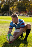 Rugby player getting ready to kick for goal Royalty Free Stock Photo