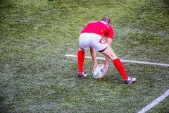 Rugby player grabs the oval ball royalty free stock images