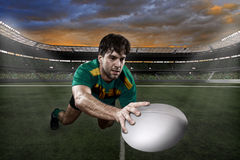 Rugby player. In a green and gold uniform on a stadium Stock Photos