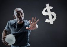 Rugby player with hand out towards dollar sign against navy chalkboard Stock Photos