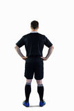 Rugby player with hands on hips Royalty Free Stock Photography