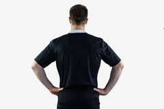 Rugby player with hands on hips Stock Photos