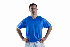 Rugby player with hands on hips Royalty Free Stock Photos