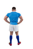 Rugby player with hands on hips Royalty Free Stock Image
