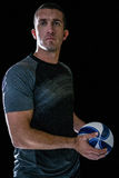 Rugby player holding ball Royalty Free Stock Photos