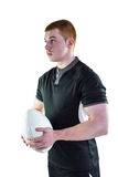 Rugby player holding a rugby ball Stock Images