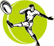 Rugby player kicking ball Stock Photos