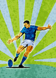 Rugby player kicking ball Stock Image