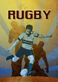 Rugby player kicking the ball Royalty Free Stock Photos