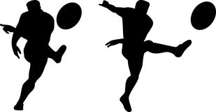 Rugby player kicking the ball Stock Photos