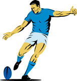 Rugby player kicking the ball Royalty Free Stock Photo