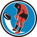 Rugby Player Kicking Ball Circle Retro Stock Photos