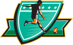 Rugby Player Kicking Ball Shield Retro Stock Images
