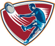 Rugby Player Kicking Ball Shield Woodcut Royalty Free Stock Photography