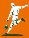 Rugby Player Kicking The Ball Stock Image