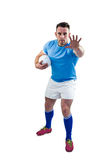 Rugby player looking at camera with hand up Royalty Free Stock Photography