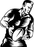 Rugby player passing the ball Royalty Free Stock Images