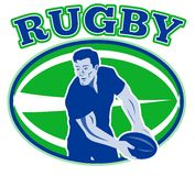 Rugby player passing ball Royalty Free Stock Images