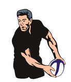 Rugby player passing ball Royalty Free Stock Photos
