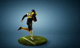Rugby player on pedestal. Mixed media stock image