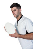 Rugby player posing with the ball Royalty Free Stock Photos