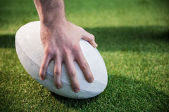 A rugby player posing a rugby ball Royalty Free Stock Image