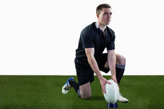 Rugby player ready to make a drop kick Stock Images