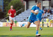 Rugby player run with ball in Rugby 7's GP game. Rugby player pictured in action during a game counting for Rugby 7's GP which took place in Bucharest. At the Stock Images