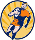 Rugby player running ball Stock Photography