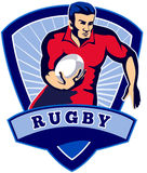 Rugby player running ball Stock Image
