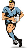 Rugby player running with ball Royalty Free Stock Photos