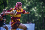 Rugby player running with ball, blurred background Royalty Free Stock Photos