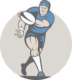 Rugby Player Running Ball Isolated Cartoon. Illustration of a rugby player running passing the ball facing front done in cartoon style on isolated background Stock Photos