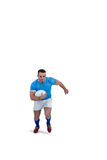 Rugby player running with the ball Stock Image