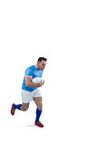 Rugby player running with the ball Royalty Free Stock Image